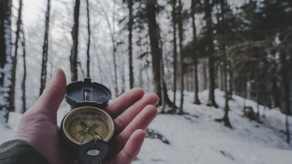 staying safe in the mountains compass and map